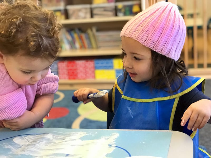 preschool - two girls at art table