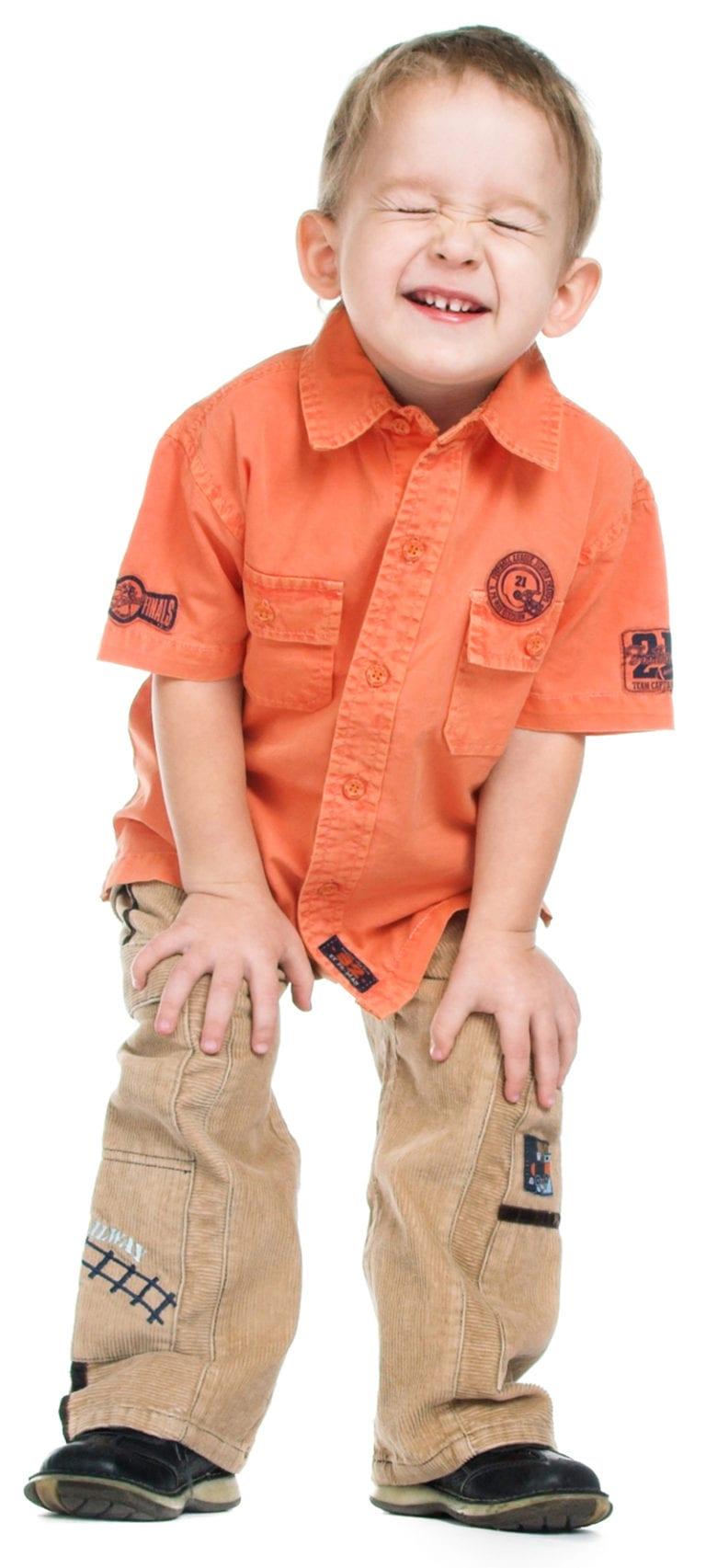 boy laughing at preschool