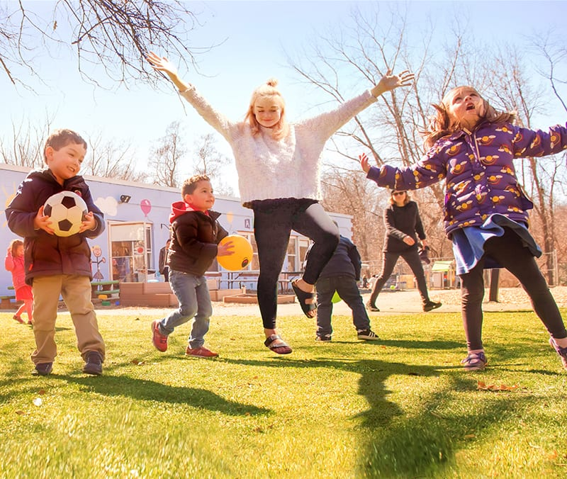 happy kids playing sports at daycare