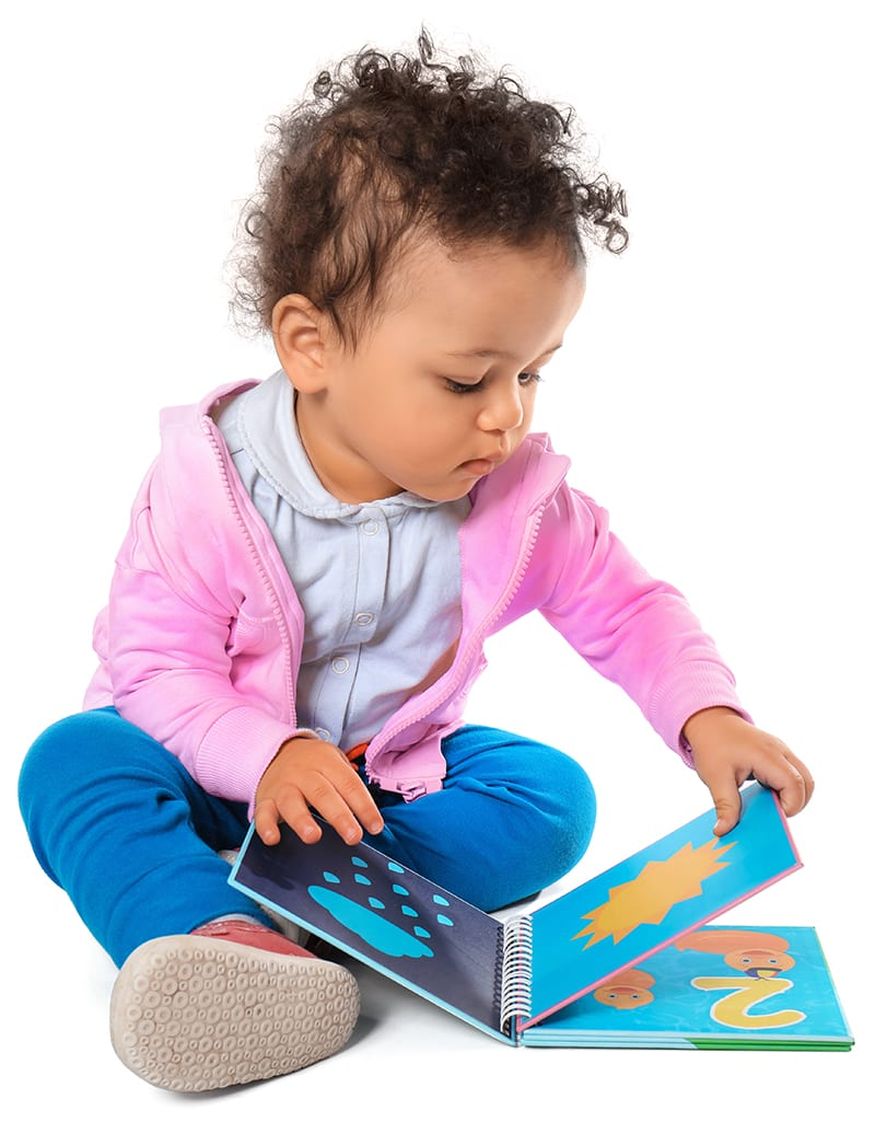 girl looking at book at daycare
