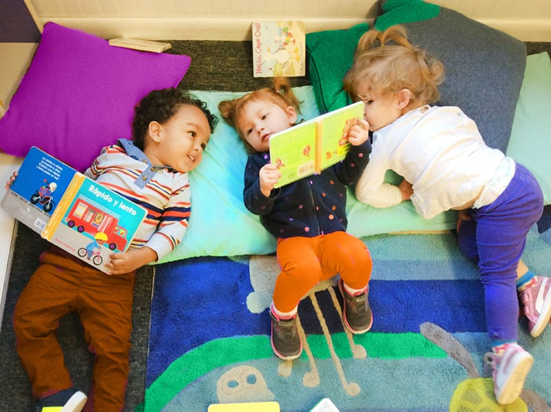 toddlers reading together at preschool