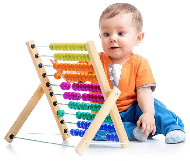 boy playing with abacus at daycare