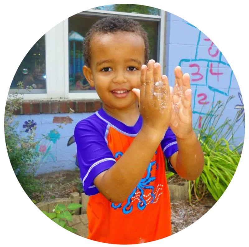 boy washing hands at preschool