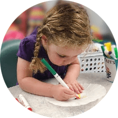 girl drawing at daycare