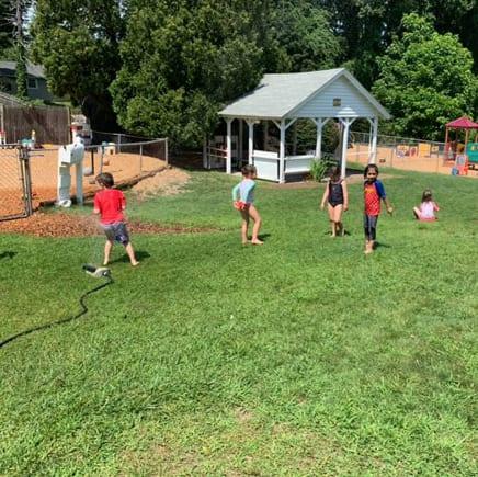 childcare sprinkler fun time at preschool